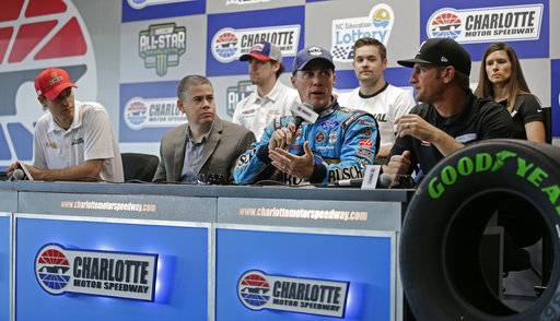 John Entz, FOX Sports President & Executive Producer, Production, second from left, listens during a news conference with NASCAR drivers, from left, Joey Logano, Ryan Blaney, Kevin Harvick, Ricky Stenhouse Jr., Clint Bowyer and Danica Patrick before practice for Saturday's NASCAR Cup series All-Star auto race at Charlotte Motor Speedway in Concord, N.C., Friday, May 19, 2017. FOX announced that the NASCAR race in Pocono will be called entirely by active Monster Energy Cup drivers. (AP Photo/Chuck Burton)