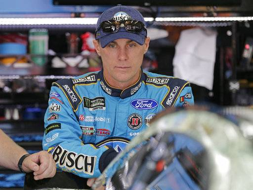 Kevin Harvick waits by his car before practice for Saturday's NASCAR Cup series All-Star auto race at Charlotte Motor Speedway in Concord, N.C., Friday, May 19, 2017.