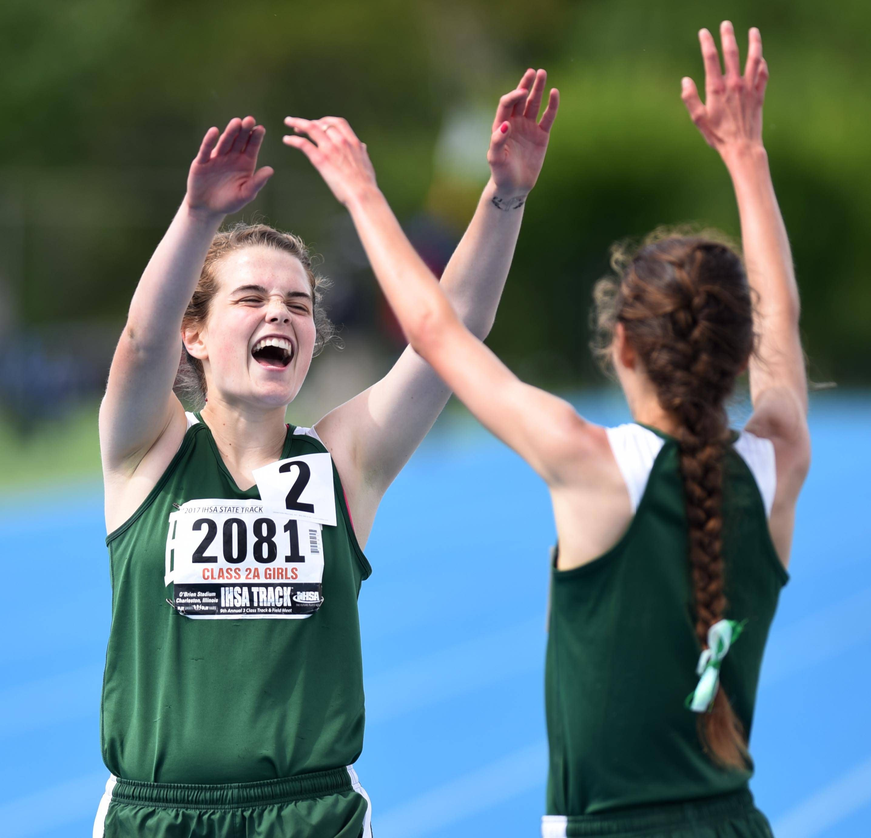 Boylan Catholic's Delaney Appino and Grace McLaughlin celebrate their first and second place finish in the Class 2A 1600-Meter Run at the state girls track and field meet finals on Saturday at Eastern Illinois University in Charleston.