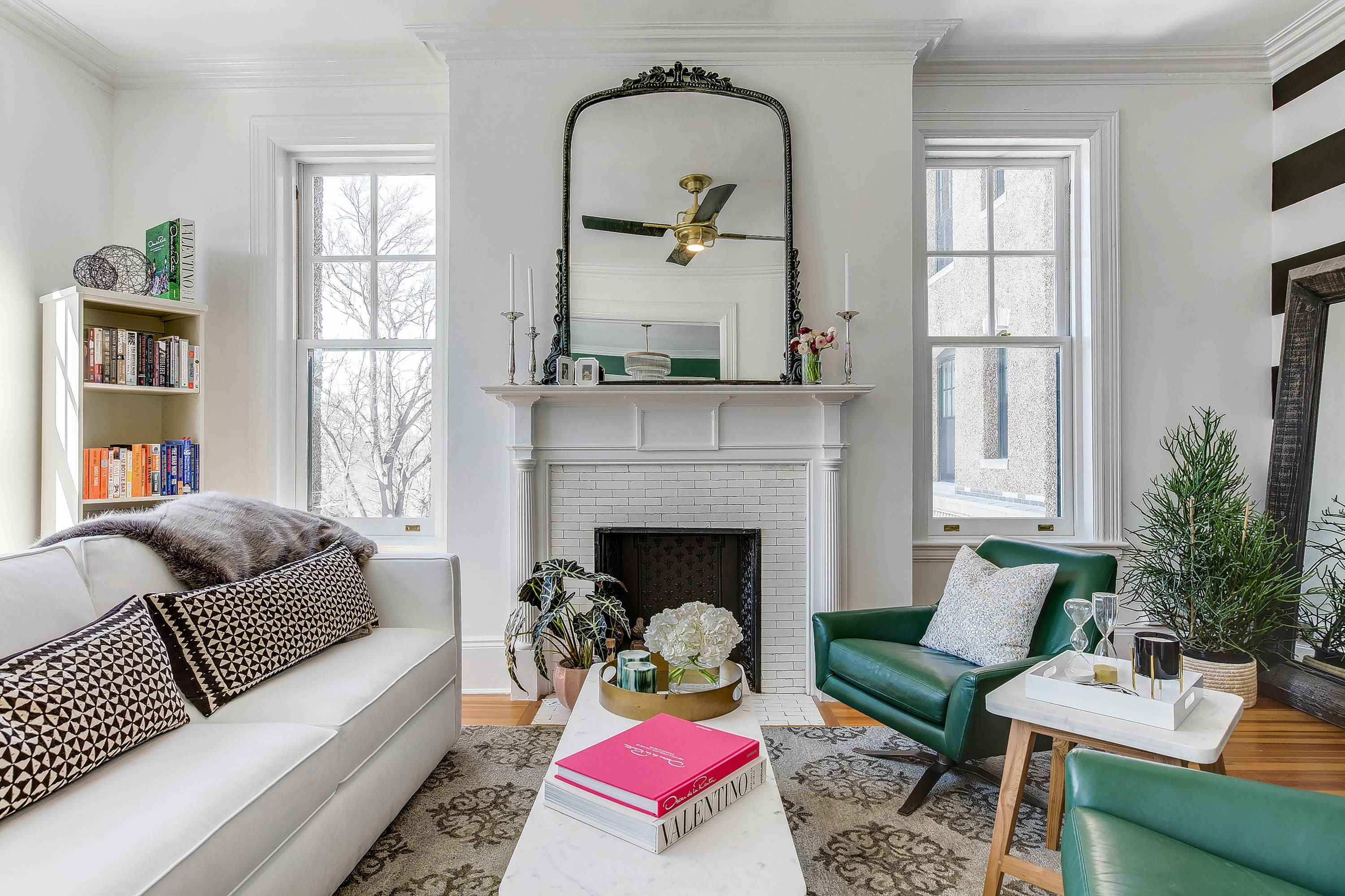 Seating in Louisa Bargeron's living room is arranged around the original fireplace and mantel.