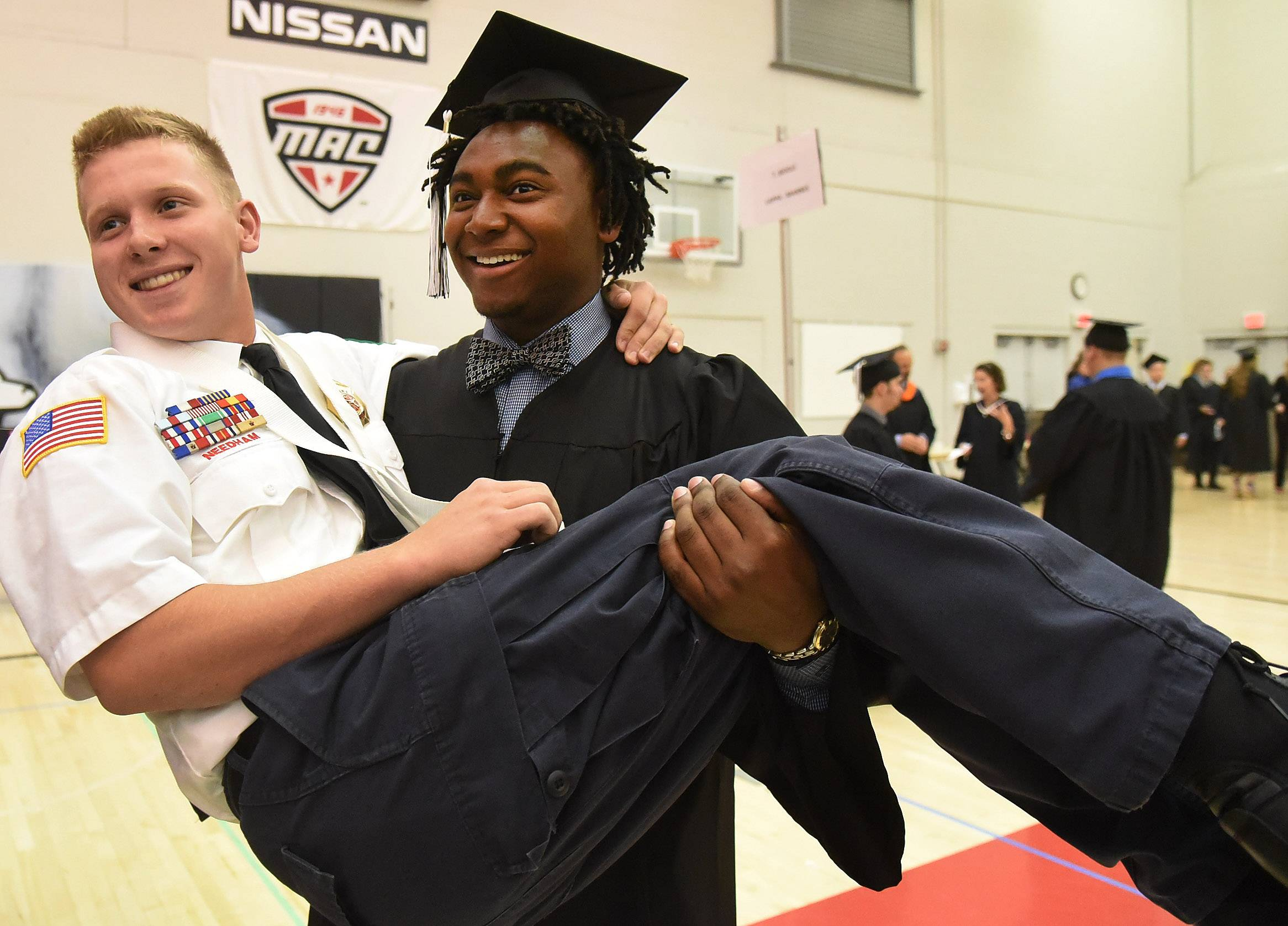 Color guard member Jake Needham gets a lift from friend Sam Suggs before commencement. Kaneland High School held their 2017 commencement ceremony on Sunday, May 21 at Northern Illinois University in DeKalb.