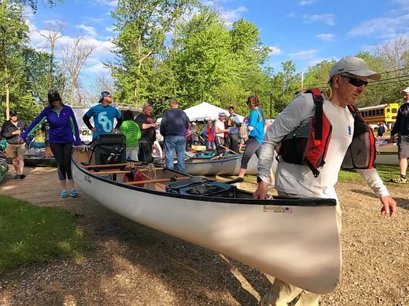 Glen and Mary Ann Moss of Libertyville carry their canoe as they prepare to launch in Libertyville.