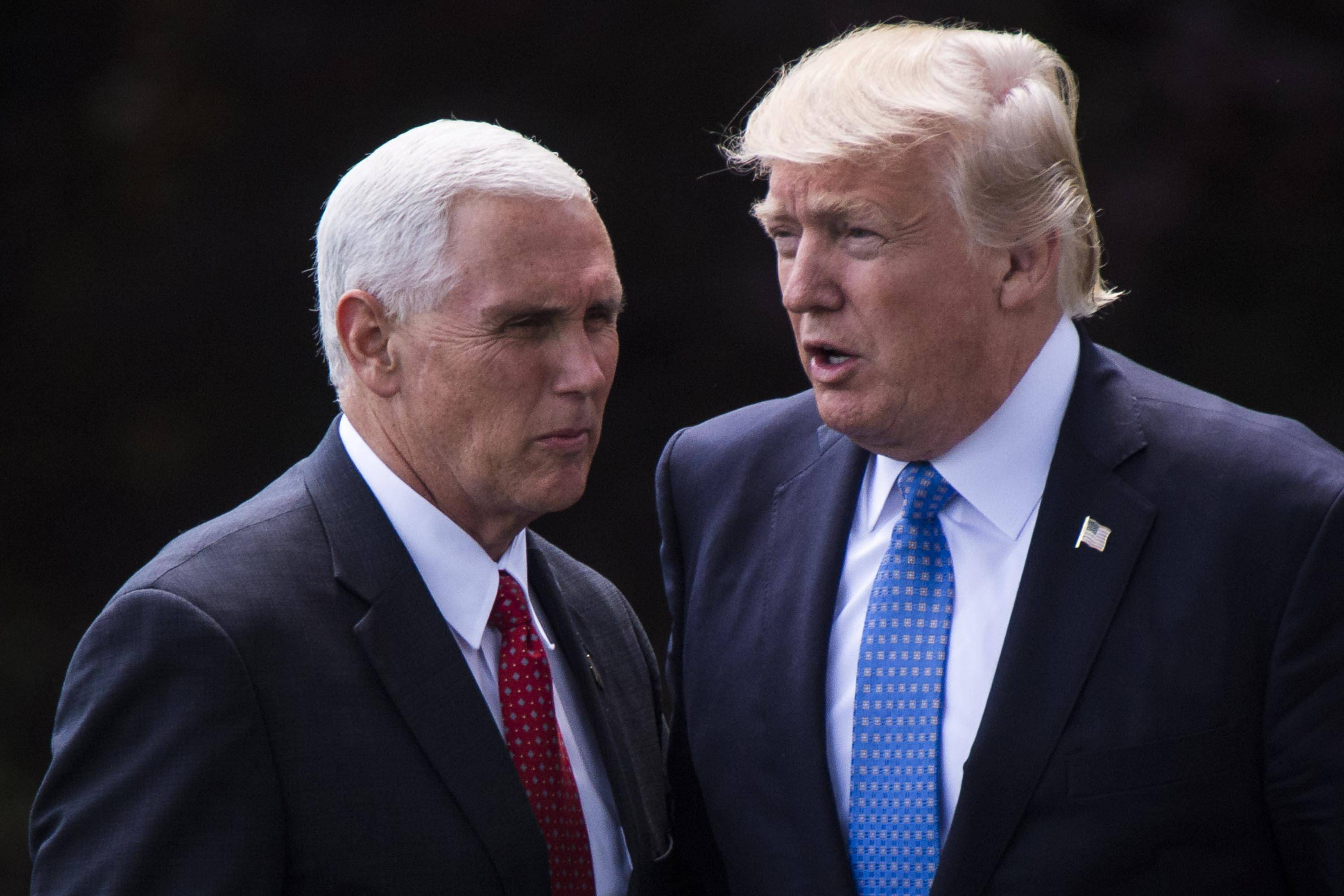President Donald Trump's first major budget proposal on Tuesday is said to include massive cuts to Medicaid and call for changes to anti-poverty programs that would give states new power to limit a range of benefits. Trump is seen here Friday with Vice President Mike Pence.