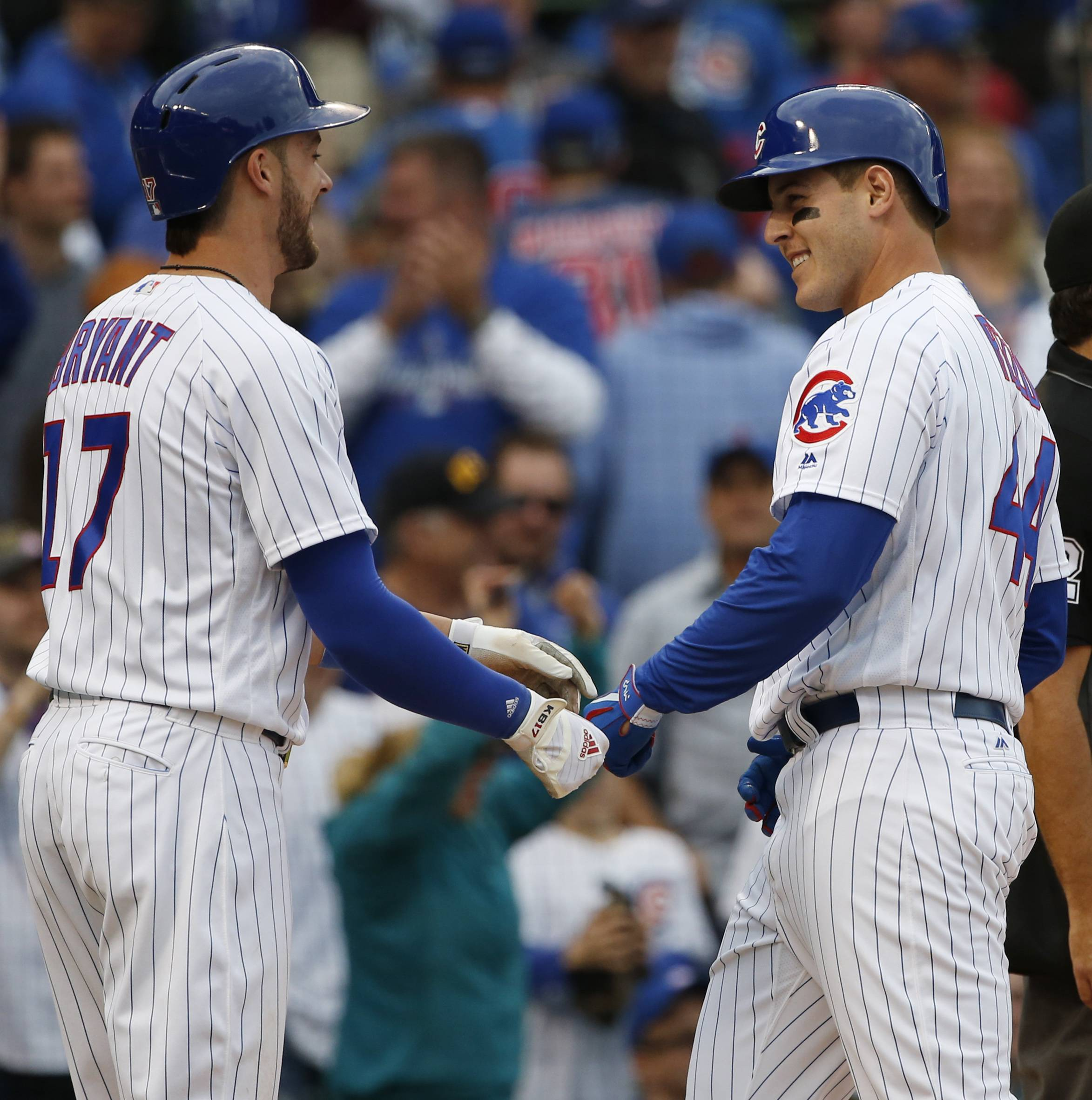 Chicago Cubs' Anthony Rizzo, right, celebrates with Kris Bryant after hitting a two-run home run against the Milwaukee Brewers in the eighth inning of a baseball game in Chicago, Sunday, May 21, 2017.