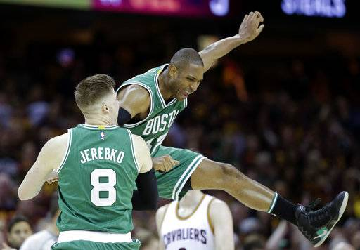 Boston Celtics' Jonas Jerebko (8), from Sweden, celebrates with Al Horford (42), from Dominican Republic, during the second half of Game 3 of the NBA basketball Eastern Conference finals, Sunday, May 21, 2017, in Cleveland. The Celtics won 111-108. (AP Photo/Tony Dejak)