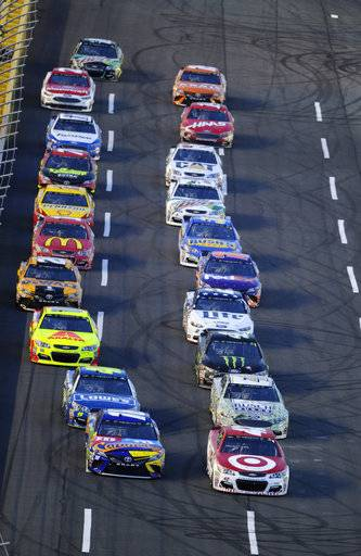 Kyle Larson, front right, and Kyle Busch, from left, lead the field at the start of the NASCAR All-Star auto race at the Charlotte Motor Speedway in Concord, N.C., Saturday, May 20, 2017. (AP Photo/Mike McCarn)