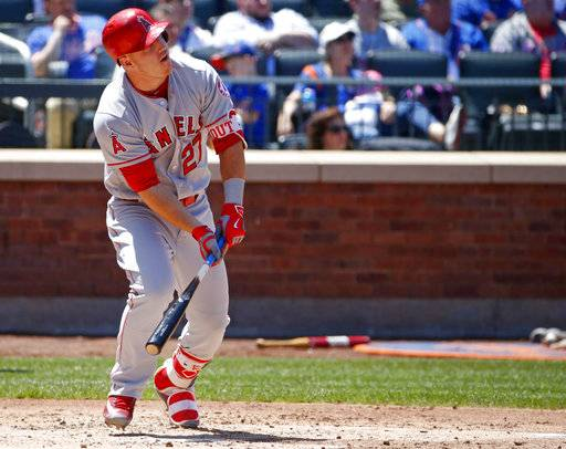 Los Angeles Angels' Mike Trout (27) watches his second-inning two-run home run during an interleague baseball game against the New York Mets, Sunday, May 21, 2017, in New York. (AP Photo/Kathy Willens)