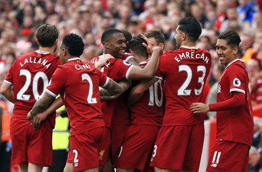 Liverpool's Philippe Coutinho, center no. 10, celebrates scoring against Middlesbrough with teammates during the English Premier League soccer match at Anfield, Liverpool, England, Sunday May 21, 2017. (Peter Byrne/PA via AP)