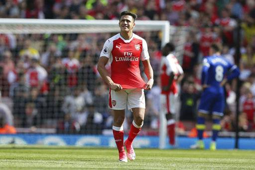 Arsenal's Alexis Sanchez looks dejected after Everton were awarded a penalty during the English Premier League soccer match between Arsenal and Everton at The Emirates stadium in London, Sunday May 21, 2017. (AP Photo/Tim Ireland)