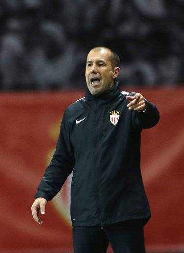 Monaco's head coach Leonardo Jardim talks to players during the League One soccer match Monaco against Saint Etienne, at the Louis II stadium in Monaco, Wednesday, May 17, 2017. (AP Photo/Claude Paris)