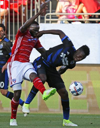 FC Dallas forward Roland Lamah (20) and San Jose Earthquakes midfielder Fatai Alashe (27) contest for position on the soccer ball in the first half of an MLS soccer game in Frisco, Texas, Saturday, May 20, 2017. (Stewart F. House/The Dallas Morning News via AP)