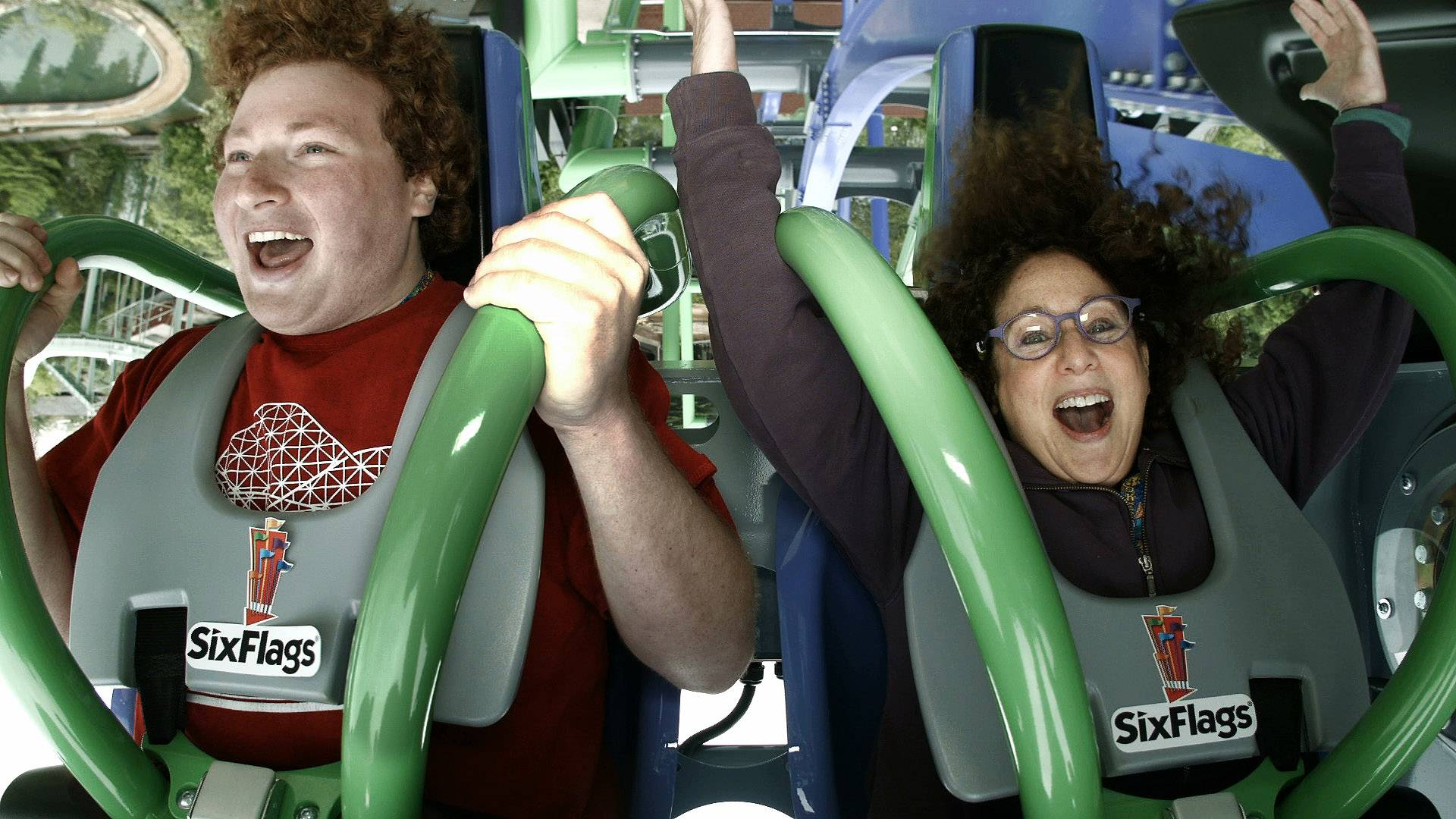 Ryan Flamm, of Deerfield and Alissa Behn of Gurnee, ride the Joker Free Fly Coaster on Thursday at Six Flags Great America in Gurnee. The amusement park will be opening the ride to the public on Saturday, May 27.]