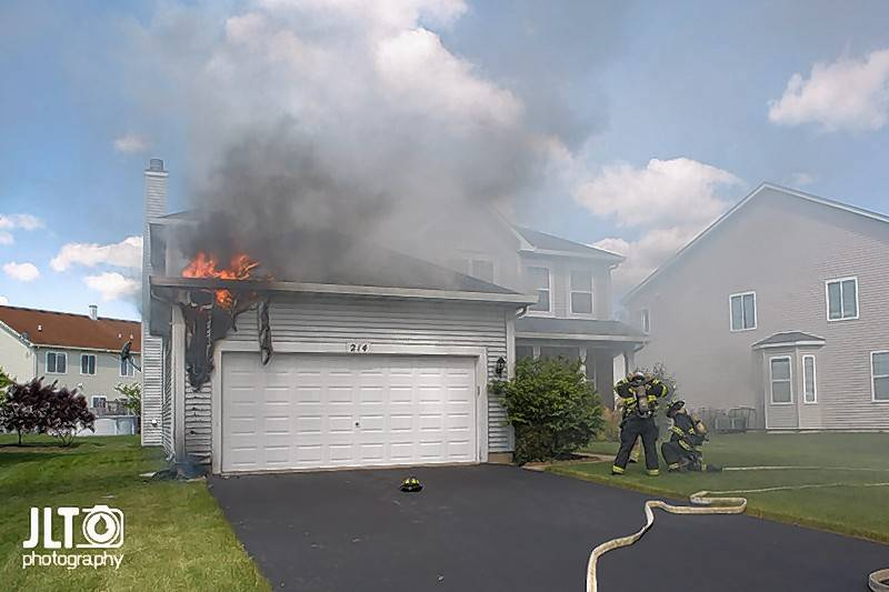 Bartlett firefighters battle a garage fire in the 200 block of Lillian Place Tueday morning.