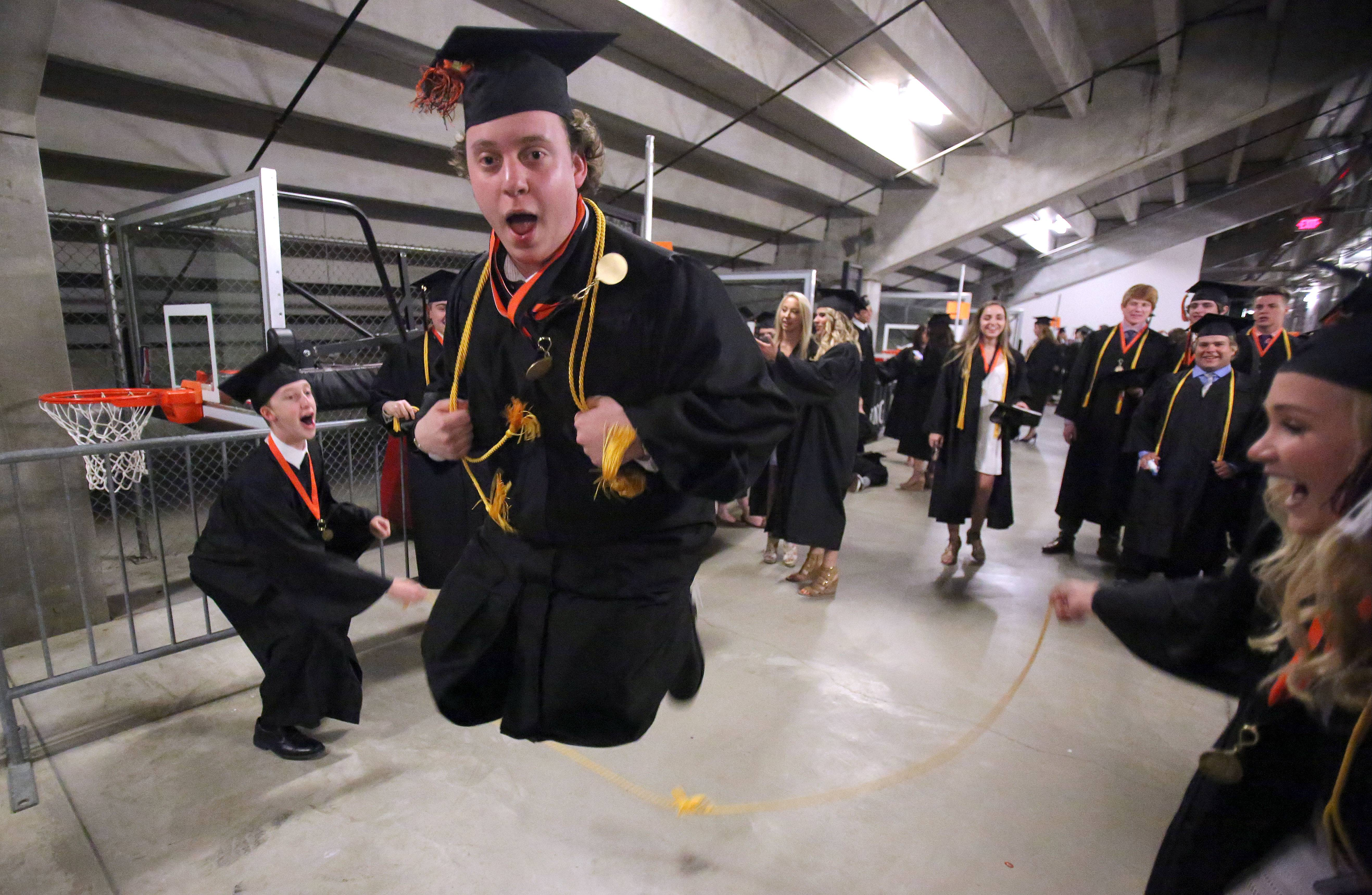 Ryan Bonate jumps rope before Libertyville High School's graduation ceremony Tuesday at the Sears Centre in Hoffman Estates.