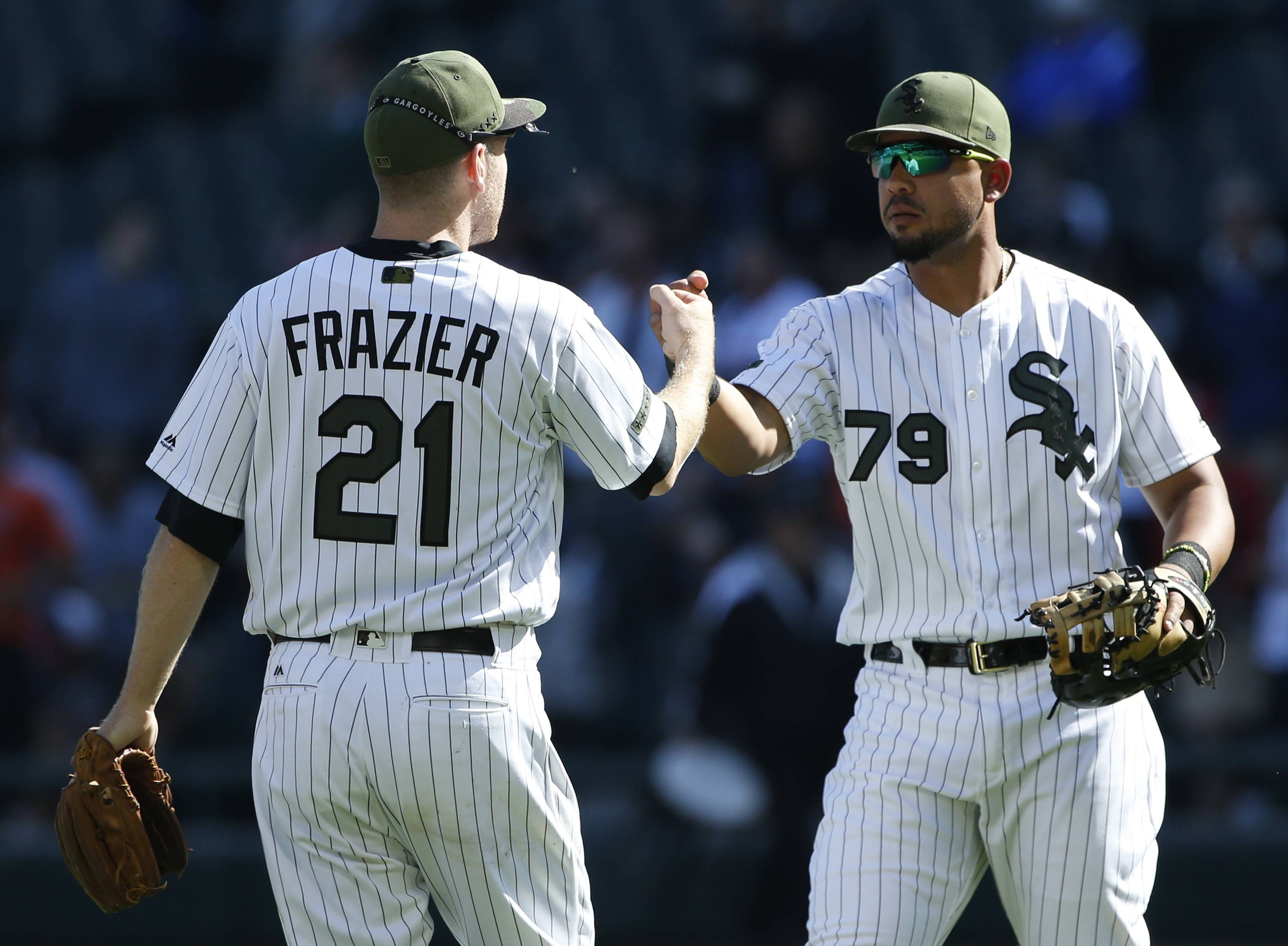 Chicago White Sox's Todd Frazier, left, celebrates with Jose Abreu after they defeated the Detroit Tigers in a baseball game, Sunday, May 28, 2017, in Chicago. (AP Photo/Nam Y. Huh)