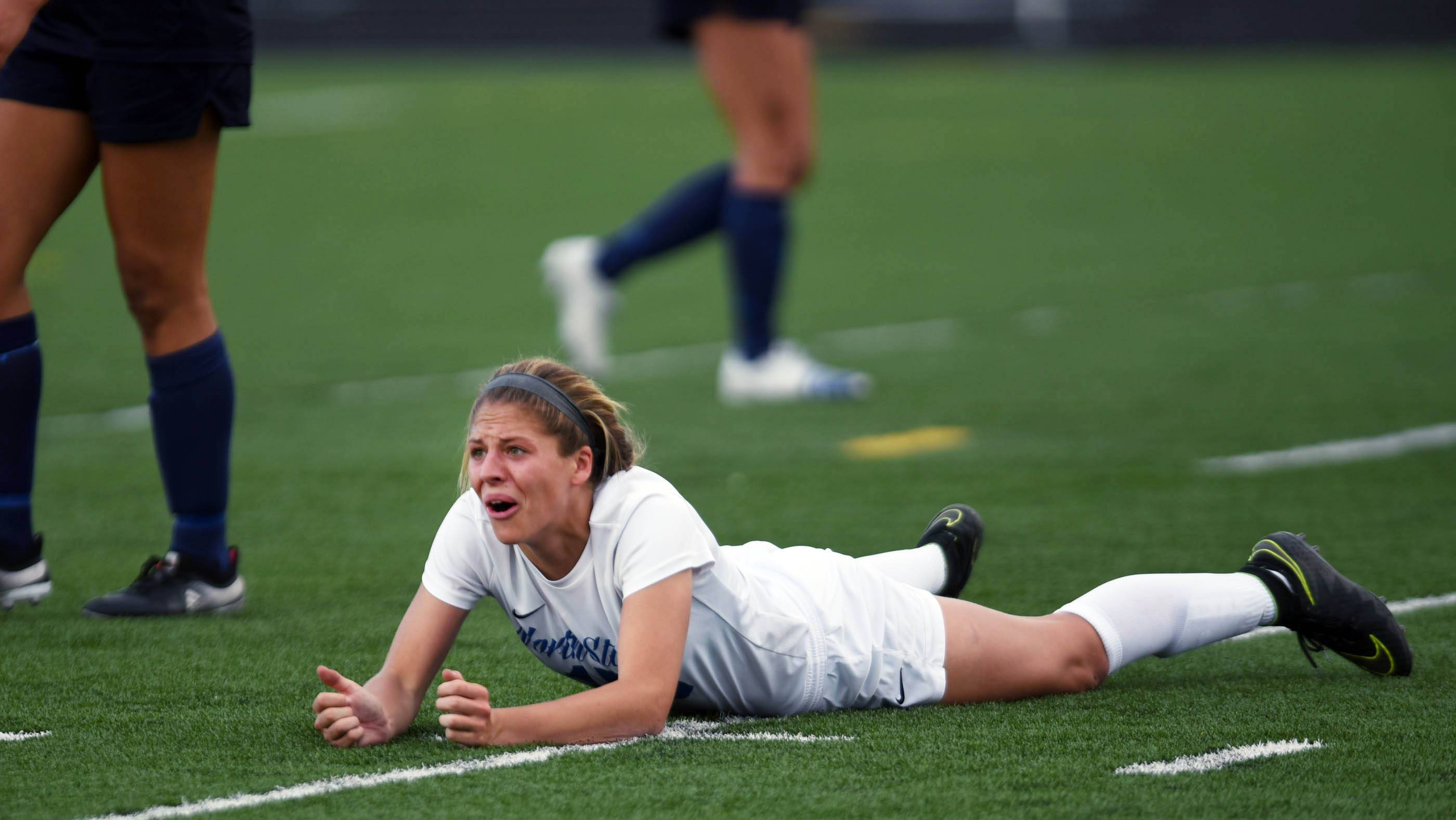 St. Charles North's Gia Wahlberg reacts to her shot that missed the net late in the game against New Trier Tuesday in the supersectional soccer game at Streamwood High School.