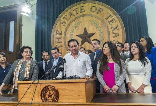 "Texas House Rep. Poncho Nevarez of district 74 speaks about the altercation that he was involved on the house floor during the last day of session at the state Capitol in Austin Monday, May 29, 2017. A raucous end to a divisive Texas legislative session erupted Monday when a large protest over a ""sanctuary cities� crackdown provoked a heated scuffle between lawmakers on the House floor. (Ricardo Brazziell/Austin American-Statesman via AP)"