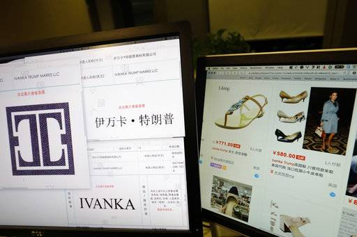 FILE - In this April 21, 2017, file photo, trademark applications from Ivanka Trump Marks LLC images taken off the website of China's trademark database are displayed next to a Chinese online shopping website selling purported Ivanka Trump branded footwear on computer screens in Beijing, China. Three men investigating a company in China that produces Ivanka Trump brand shoes are missing, according to Li Qiang who runs China Labor Watch, a New York-based labor rights group that was planning to publish a report in June, 2017, about low pay, excessive overtime and the possible misuse of student interns at one of the company's factories. (AP Photo/Ng Han Guan, File)