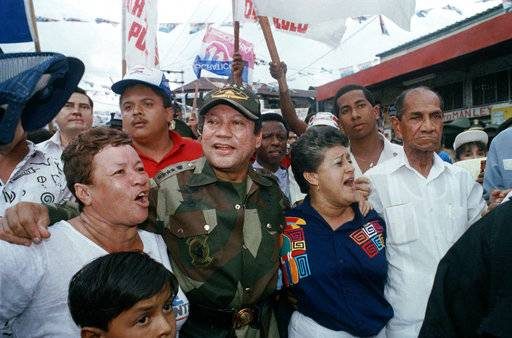 "ADDS CONFIRMATION BY PANAMANIAN PRESIDENT, FILE - In this May 2, 1989 file photo, Gen. Manuel Antonio Noriega walks with supporters in the Chorrilo neighborhood, where he dedicated a new housing project, in Panama City. Former Panamanian dictator Noriega died late Monday, May 29, 2017, at age 83. Panamanian President Juan Carlos Varela wrote in his Twitter account that ""the death of Manuel A. Noriega closes a chapter in our history.� (AP Photo/John Hopper, File)"