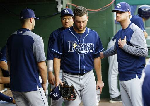 Tampa Bay Rays starting pitcher Matt Andriese, center, leaves the game during the second inning of a baseball game against the Texas Rangers in Arlington, Texas, Tuesday, May 30, 2017. (AP Photo/LM Otero)