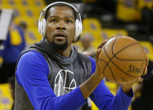 "In this Sunday, May 14, 2017, photo, Golden State Warriors forward Kevin Durant warms up before Game 1 of the NBA basketball Western Conference finals between the Warriors and the San Antonio Spurs in Oakland, Calif. Imagine Kevin Durant as a skinny, timid teen being told to shoot by his middle school point guard who saw so much potential all those years ago. San Francisco 49ers linebacker NaVorro Bowman, the superior player at the time, used to tell tall-and-lanky Durant to be aggressive, to take it to the hoop. ""Can you believe we had to tell him to shoot?"" Bowman recalled with a grin. (AP Photo/Jeff Chiu)"