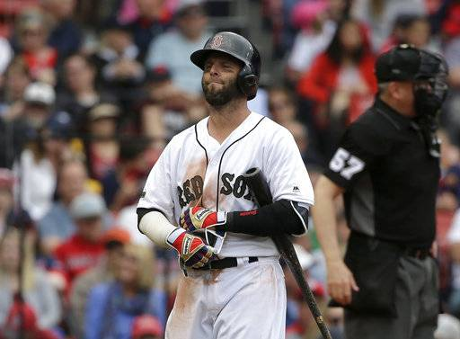 Boston Red Sox's Dustin Pedroia walks to the dugout after he struck out swinging off a pitch by Seattle Mariners' Edwin Diaz in the ninth inning of a baseball game, Sunday, May 28, 2017, in Boston. The Mariners shut out the Red Sox 5-0. (AP Photo/Steven Senne)