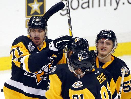 Pittsburgh Penguins' Evgeni Malkin, left, celebrates his goal against the Nashville Predators with teammates during the first period in Game 1 of the NHL hockey Stanley Cup Final, Monday, May 29, 2017, in Pittsburgh. (AP Photo/Gene J. Puskar)