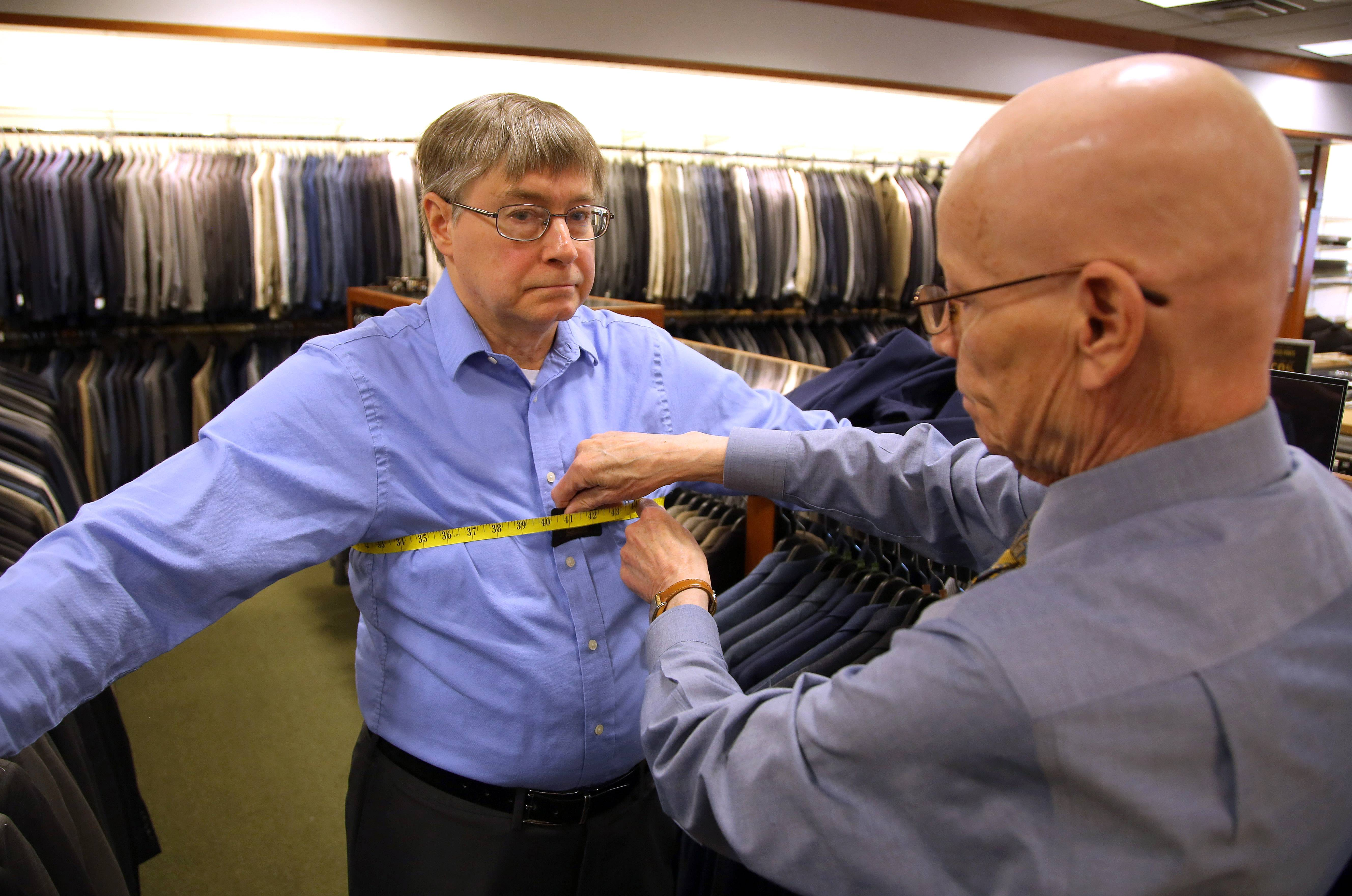 Steve Lundy/slundy@dailyherald.comFittest Loser contestant Dave Gathman of Elgin gets measured by Dennis Carnehl at Jos. A. Bank in Deer Park Mall Tuesday.