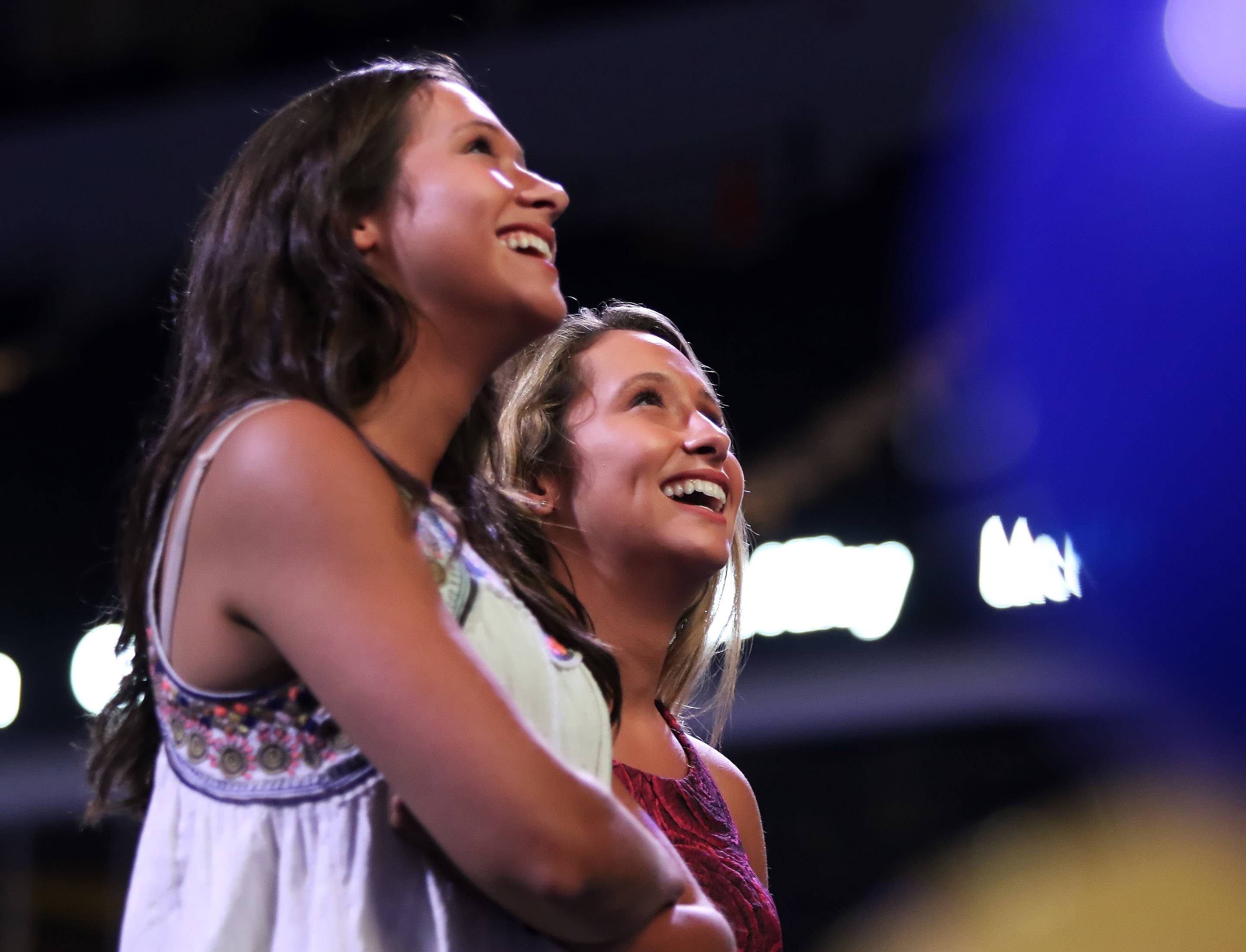 "Libertyville High School athletes Claire and Kelly Keefe watch a video after winning ""Overcoming Obstacles"" award during the Daily Herald Preps Sports Excellence Awards Monday night at the Sears Centre Arena in Hoffman Estates. About 1,000 people attended the banquet recognizing the best athletes and coaches in the area for the past school year."