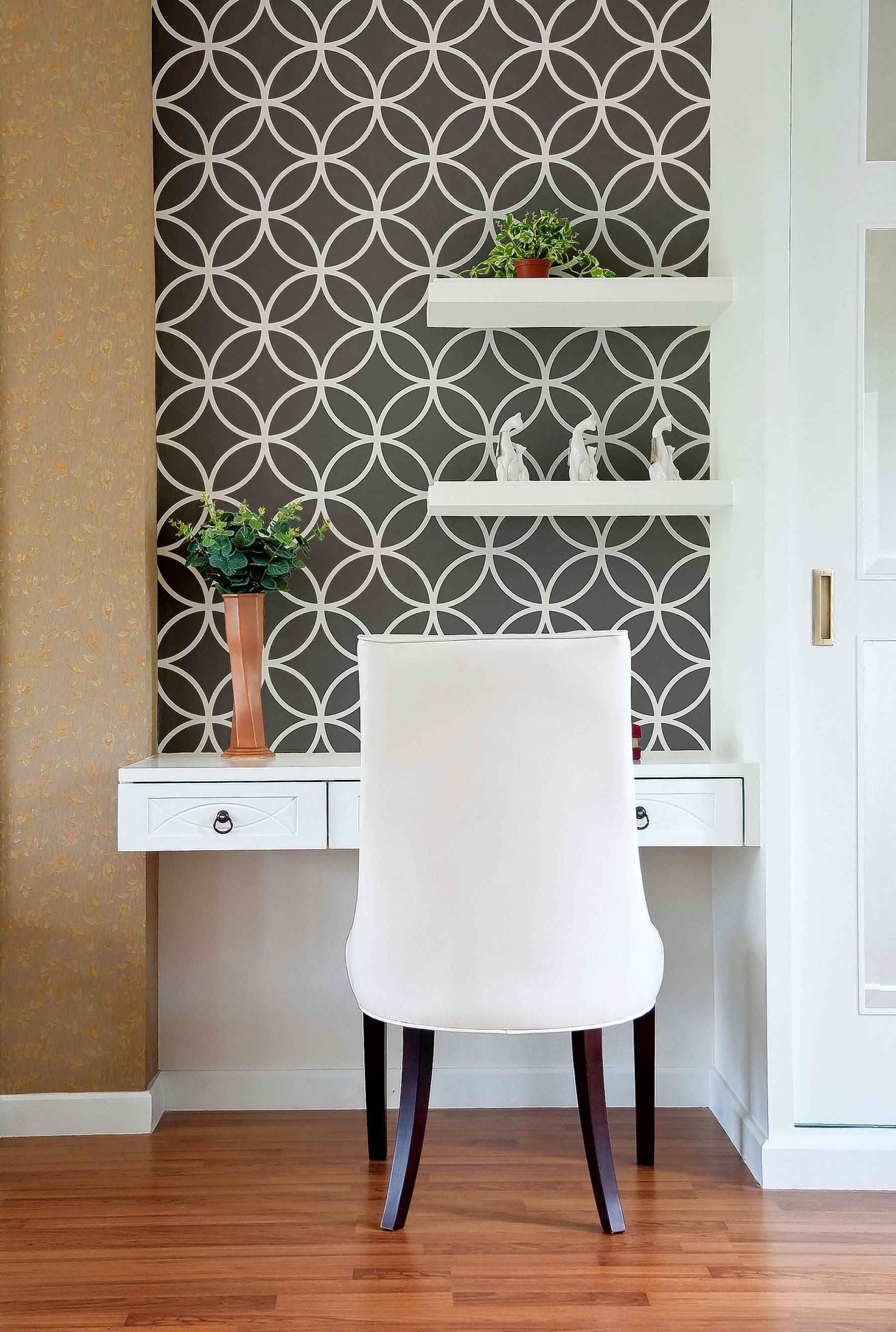 This work alcove finds space in a hallway and is made unique with geometric wallpaper.