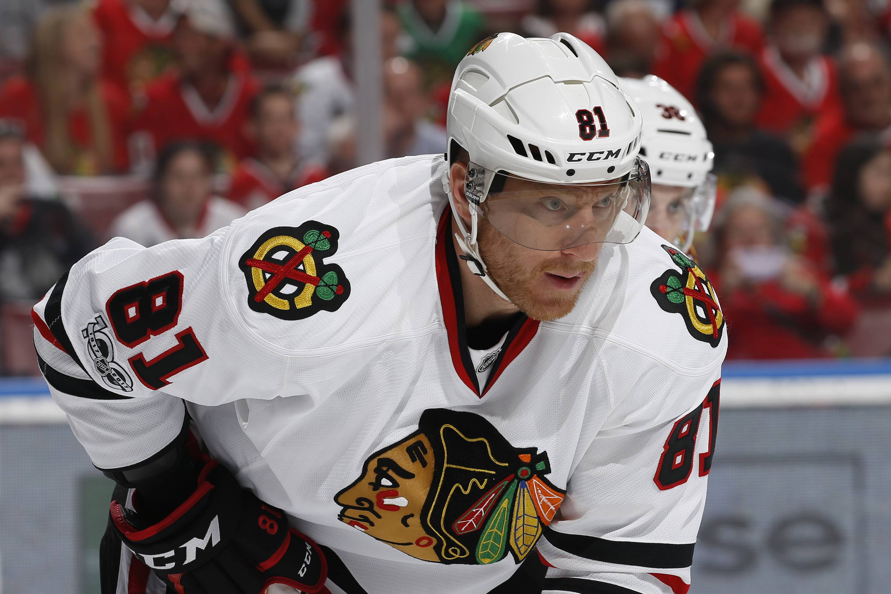 FILE - In this Saturday, March 25, 2017, file photo, Chicago Blackhawks right wing Marian Hossa (81) prepares for a face off against the Florida Panthers during the first period of an NHL hockey game, in Sunrise, Fla. Hossa will miss the entire 2017-18 NHL season because of a progressive skin disorder, the team announced the news early Wednesday, June 21, 2017. (AP Photo/Joel Auerbach, File)