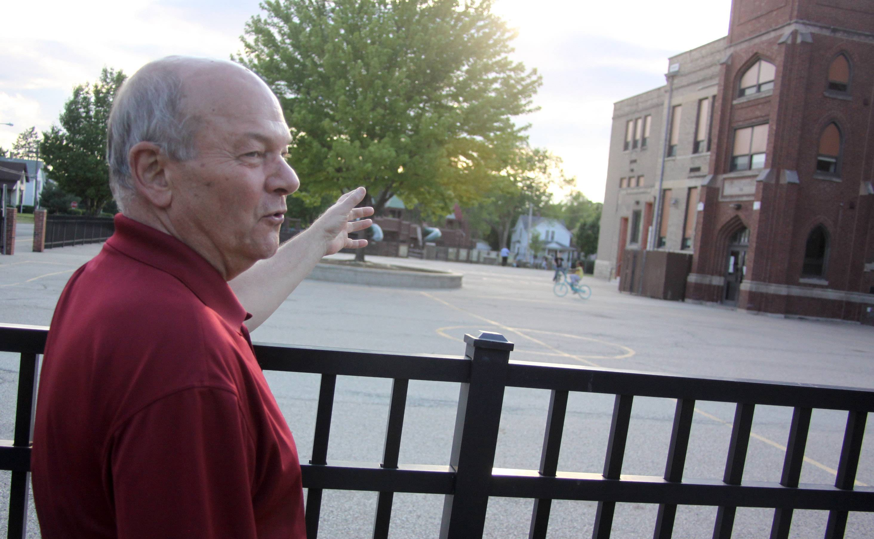 "Elgin Mayor David Kaptain, during a ""Walk with the Mayor"" a few years ago, pauses to admire the architecture of McKinley Elementary School, one of the oldest in District U-46."