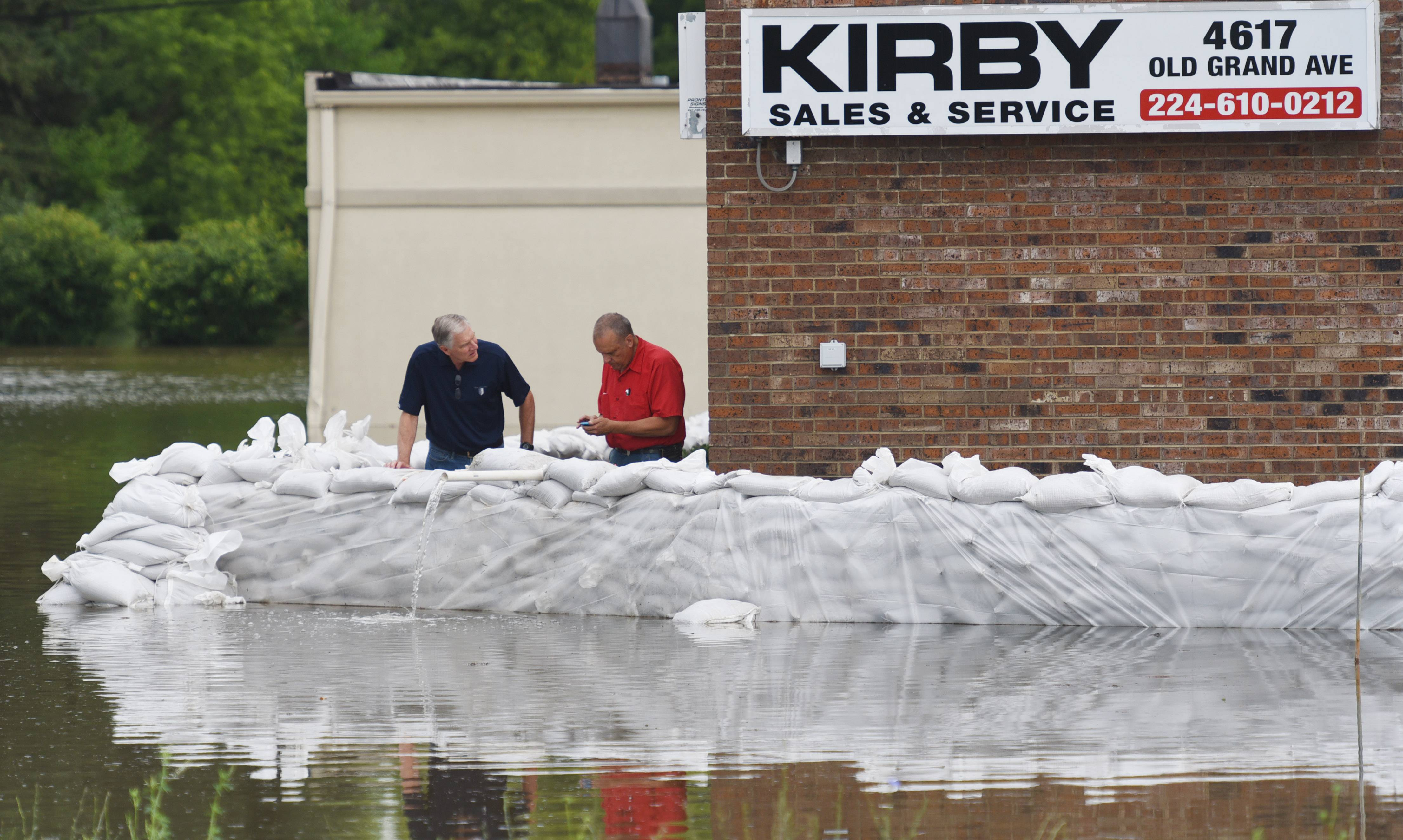 Sandbags protect businesses along Old Grand Avenuee in Gurnee Thursday.