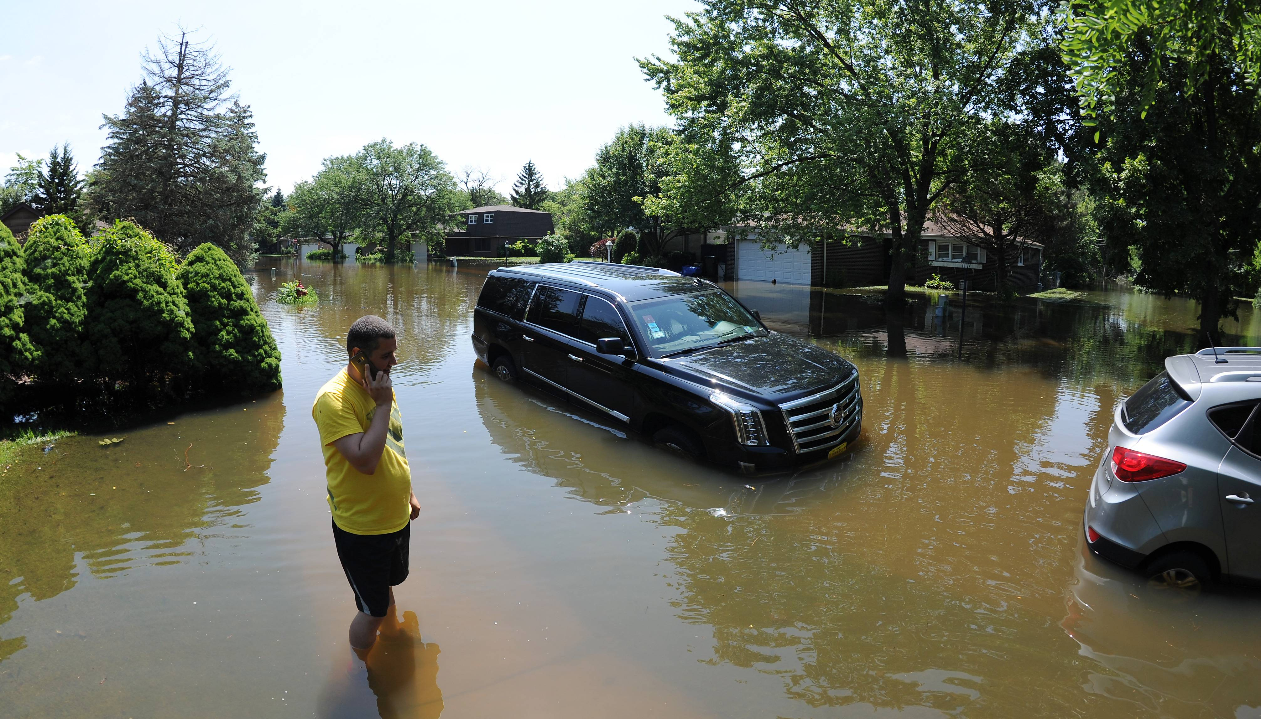 Due to flooding in areas like Des Plaines, Gov. Bruce Rauner on Sunday declared Cook County a state disaster area. The declaration will help residents like Cata Sebe, whose car got caught up in the floodwaters on Big Bend Drive, get assistance.