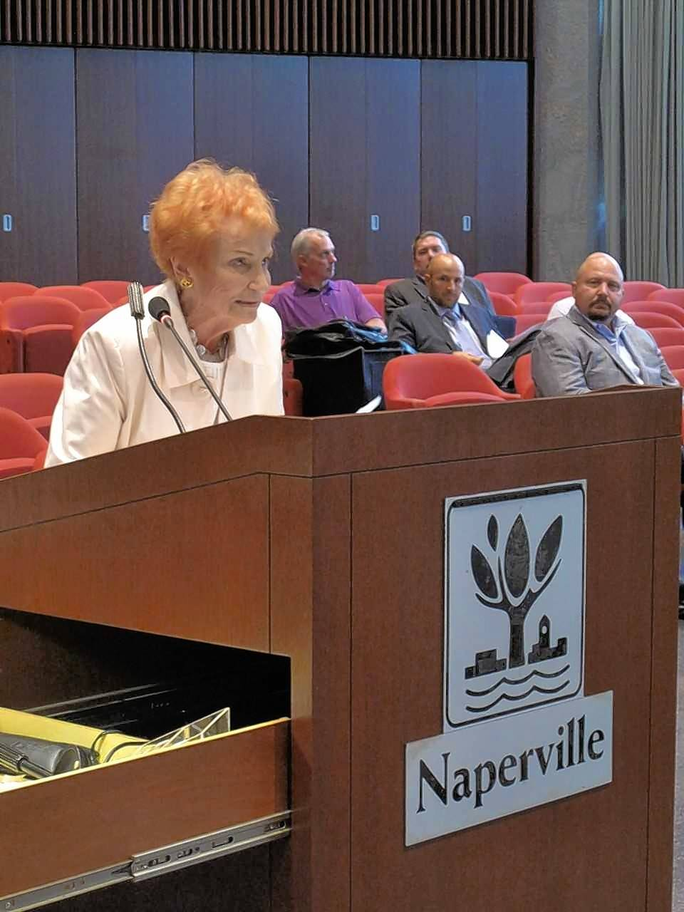 Dolle Nichols, 91, pleads with the Naperville City Council to spare the city's original Nichols Library, named in honor of her great-grandfather, from a development proposal that would incorporate its facade into a new mixed-use center.