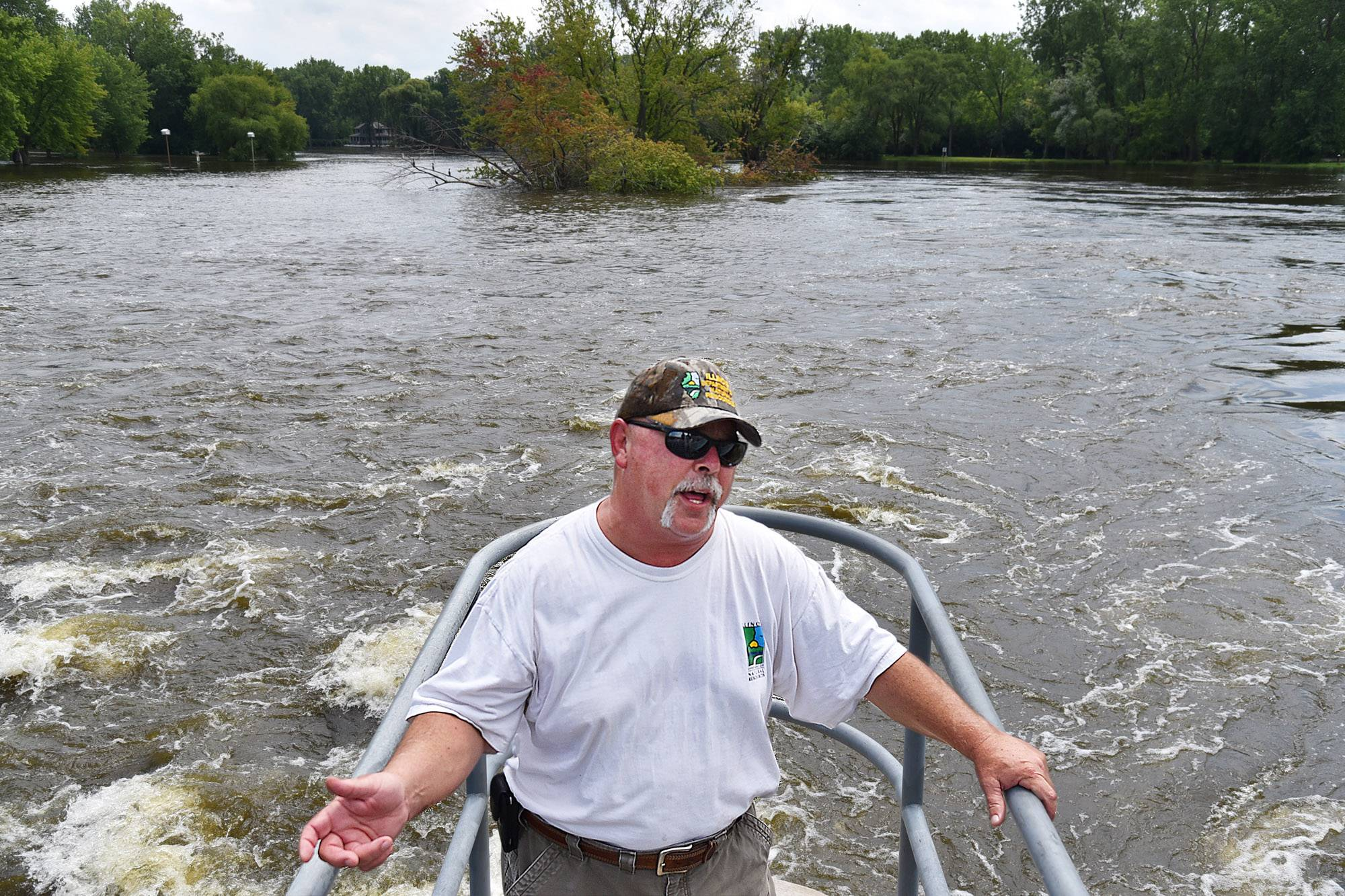 With the gates of the William G. Stratton Lock & Dam wide open, lockmaster John Palmieri explains how manipulating the water flow at this dam in McHenry can ease flooding, but can't stop it.