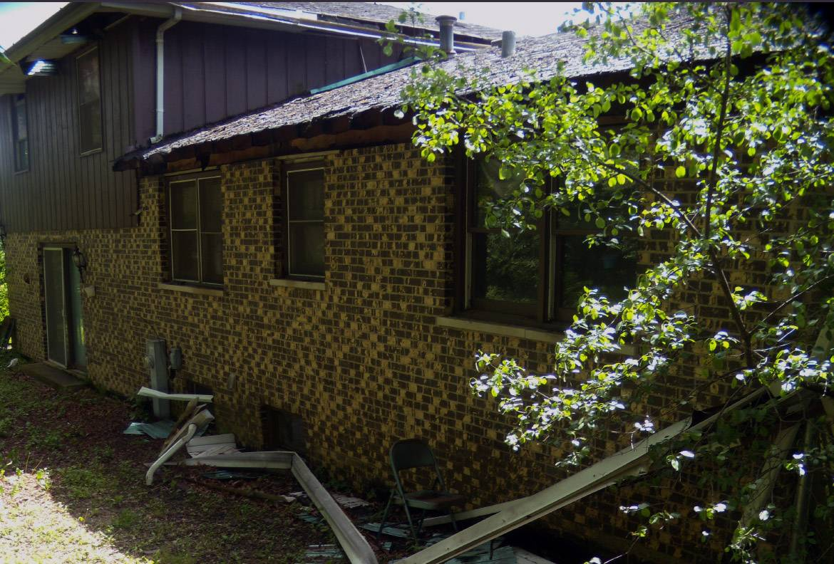 DuPage officials say the owner of a dilapidated house near Hinsdale agreed to demolish the home as part of the county's Neighborhood Revitalization Program.