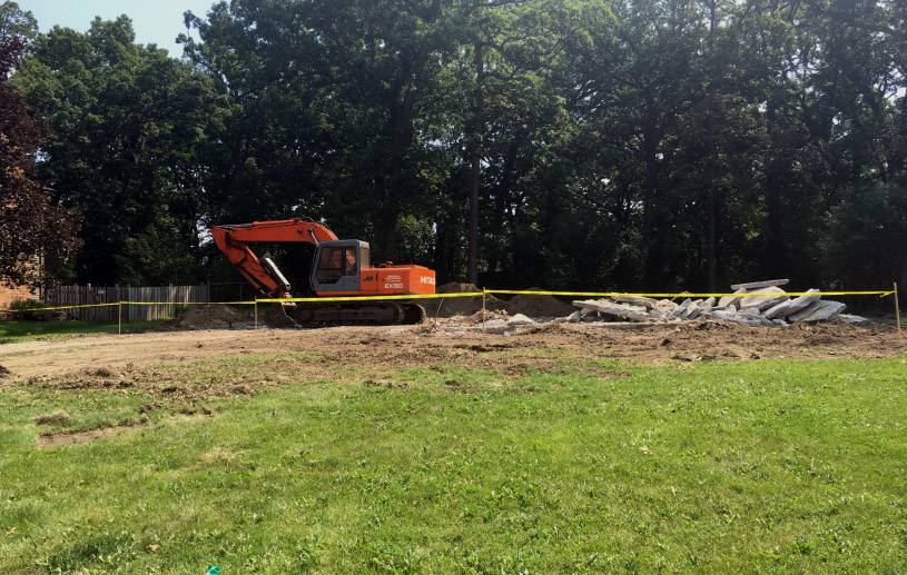 DuPage County officials worked with a property owner who agreed to demolish his dilapidated house near Hinsdale. After the home was razed, the foundation was removed and the area was seeded for grass.