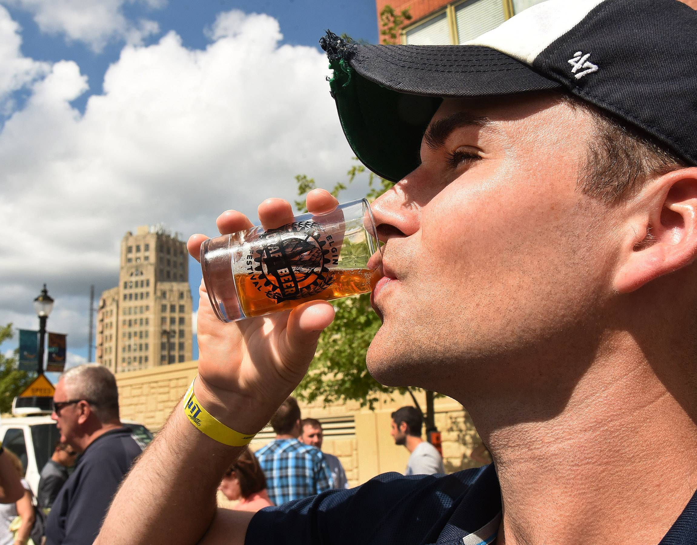 Andrew Freeman of South Elgin samples a beer from Wild Onion Brewing in Barrington during the Elgin Craft Beer Festival Saturday.
