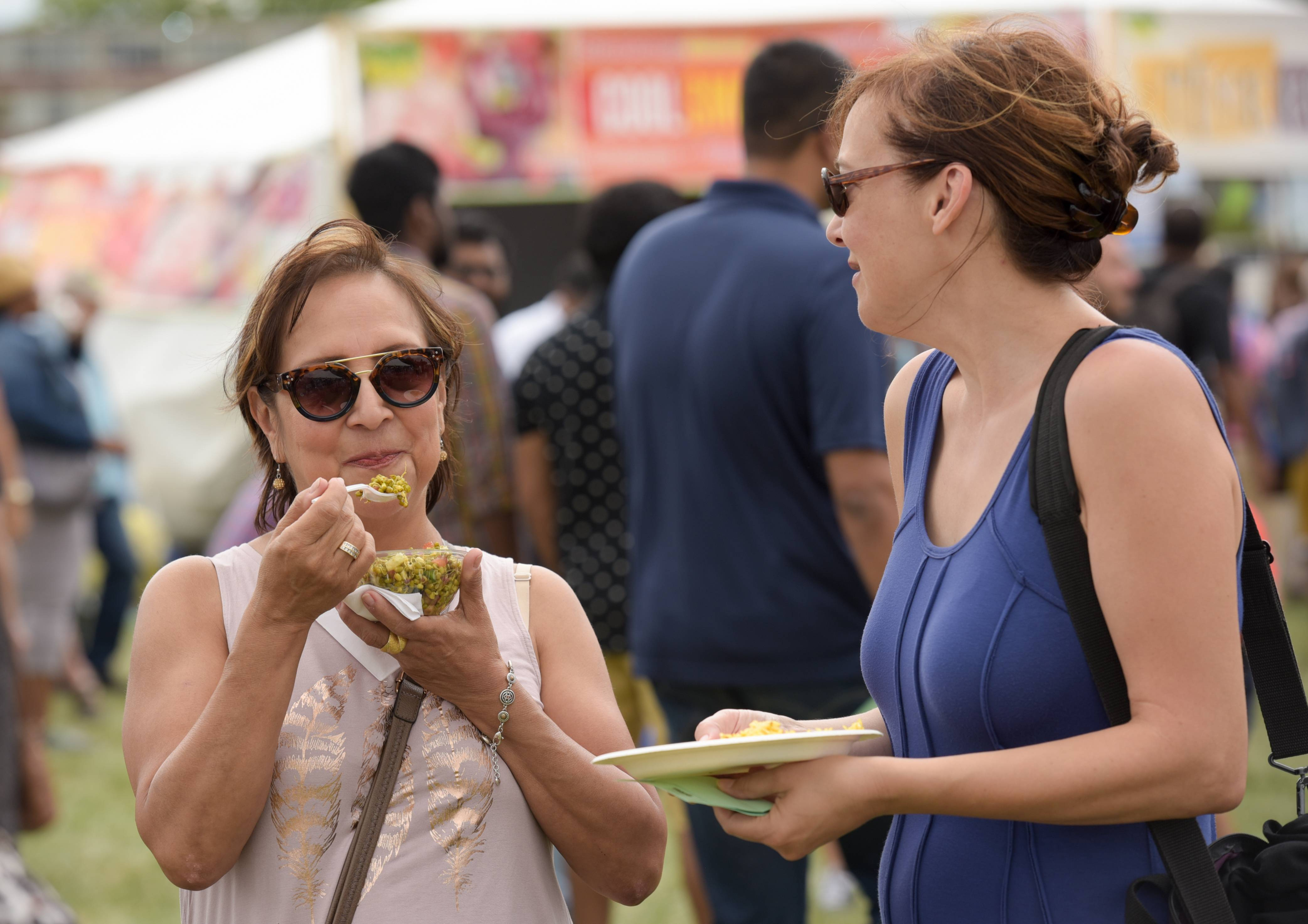 Laura Martinez of Naperville enjoys some lentils and Jennifer Ahern of Westchester enjoys a falafel while at the 12th annual Veggie Fest held this year at Benedictine University in Lisle.