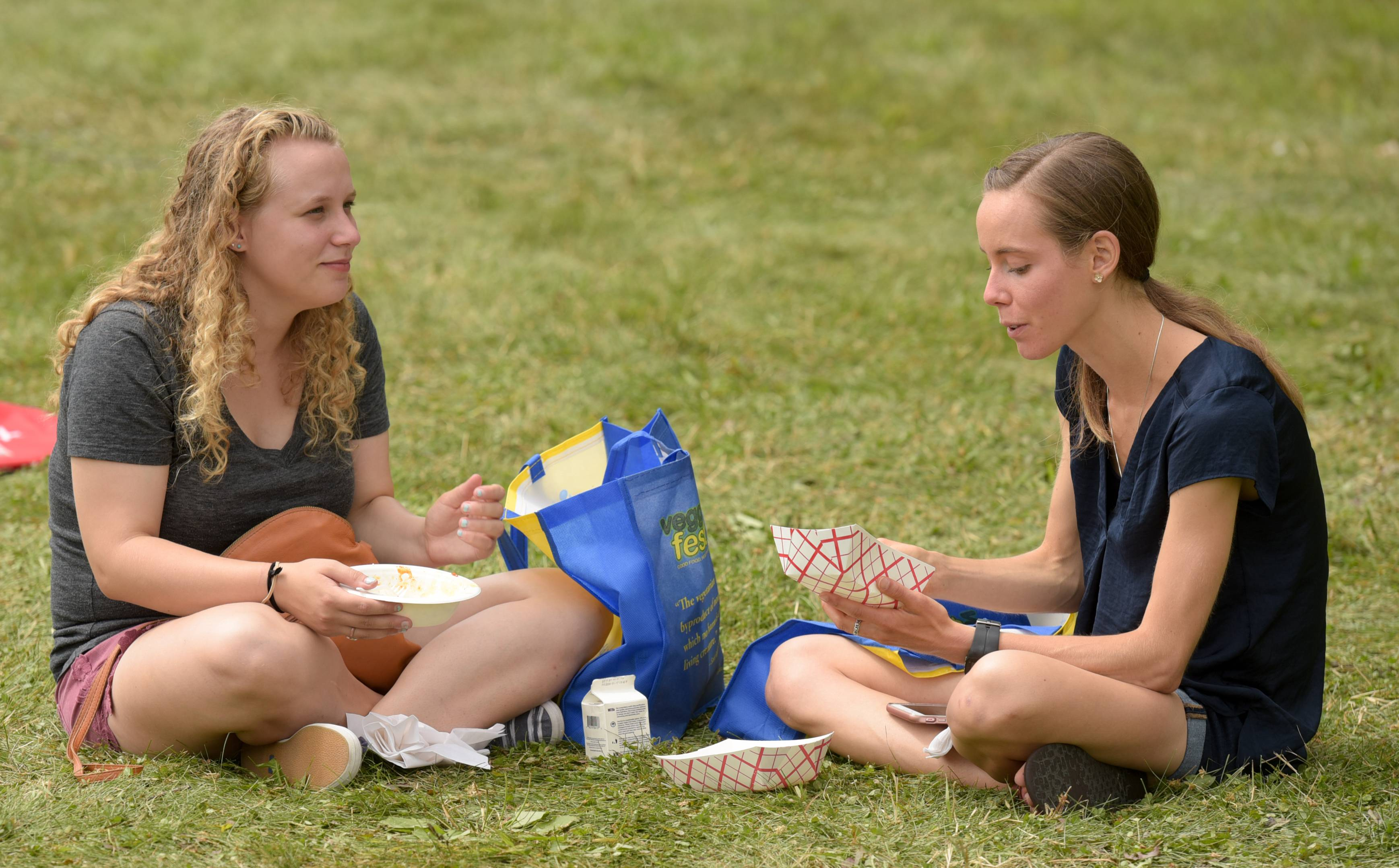 Michelle Fairbarin of New Lenox enjoys a Buddha bowl and Jenny Jess of Lansing Michigan enjoys a Thai crunch salad while at the 12th annual Veggie Fest held this year at Benedictine University in Lisle.