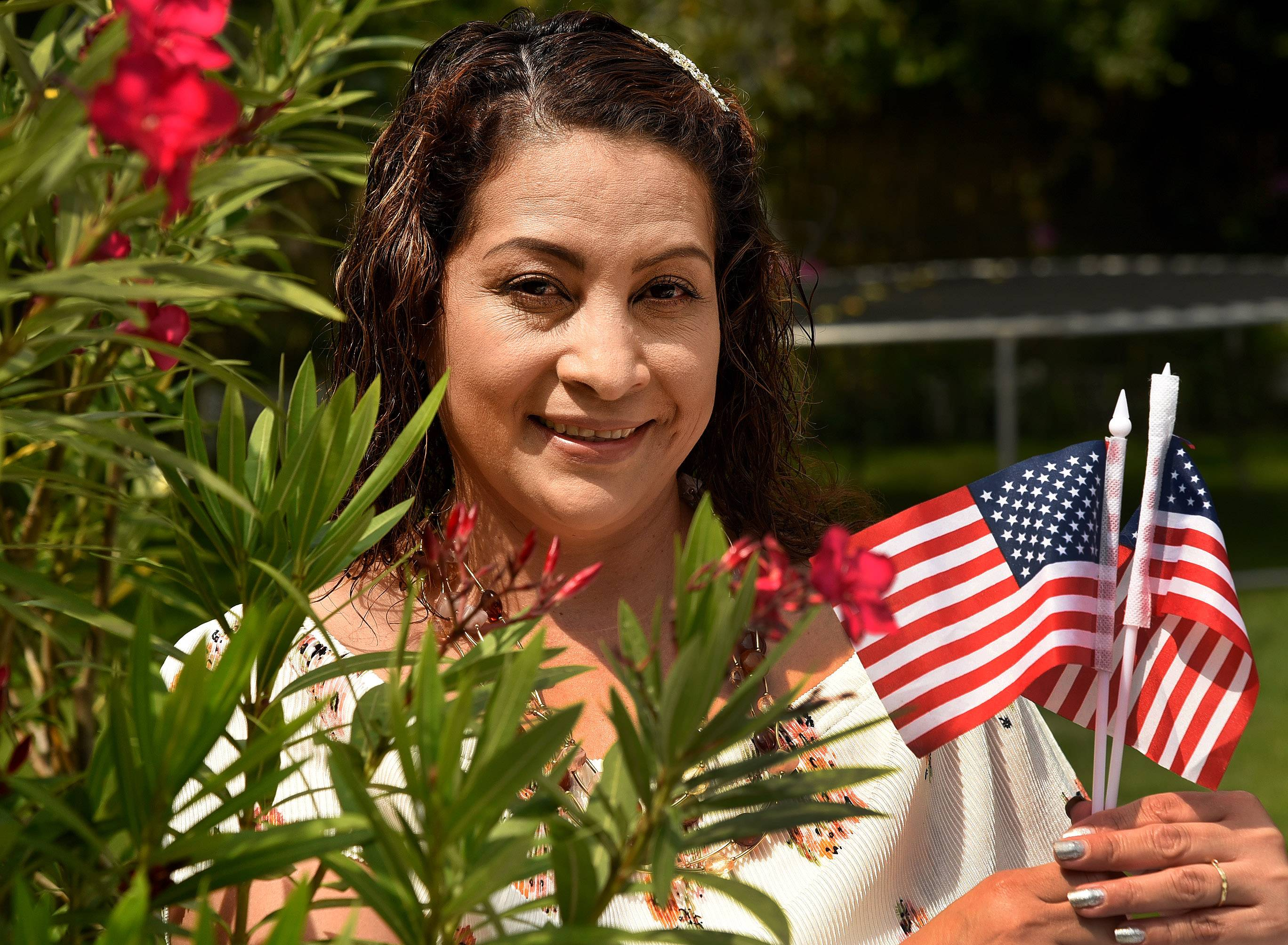 Leticia Rojas became a new citizen in September 2016. Here she is in her backyard in Elgin.