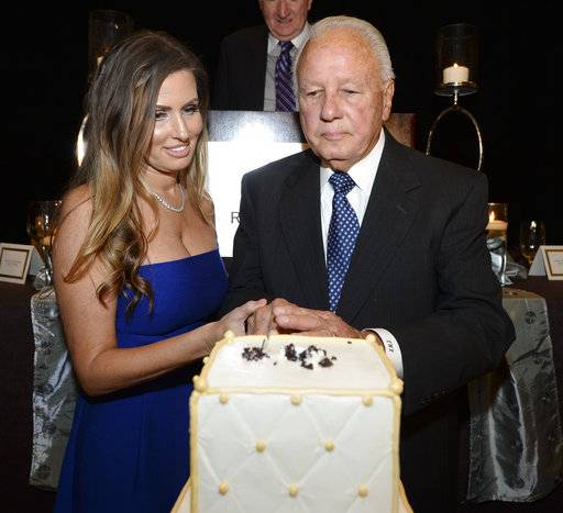 Trina Edwards, left, joins her husband, former Louisiana Governor Edwin Edwards, as he cuts a cake in celebration of his 90th birthday, Saturday, Aug. 12, 2017, at the Renaissance Hotel in Baton Rouge, La. (Hilary Scheinuk /The Advocate via AP)
