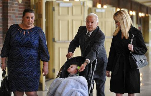 FILE - In this March 17, 2014 file photo, Former Louisiana Gov. Edwin Edwards, center, walks down the hallway pushing his son, Eli, as he is accompanied by wife Trina Scott Edwards, right, and Charlotte Guedry, left, before speaking at the Baton Rouge Press Club in Baton Rouge, La. Louisiana's four-term former governor Edwards is having an ostentatious 90th birthday bash, Saturday, Aug. 12, 2017, with a $250-per-person price tag to attend. The powerful and charismatic Edwards was the dominant figure in Louisiana politics for decades before he went to federal prison for a corruption conviction. Out of prison for six years, he's got a wife five decades his junior, a 4-year-old son and continued popularity in his home state.
