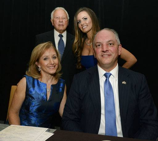 Counter clockwise from bottom left, first lady of Louisiana Donna Edwards, former Louisiana Gov. Edwin Edwards, Trina Edwards, and Louisiana Gov. John Bel Edwards pose for a photo while celebrating Edwards' 90th birthday, Saturday, Aug. 12, 2017, at the Renaissance Hotel in Baton Rouge, La. (Hilary Scheinuck /The Advocate via AP)