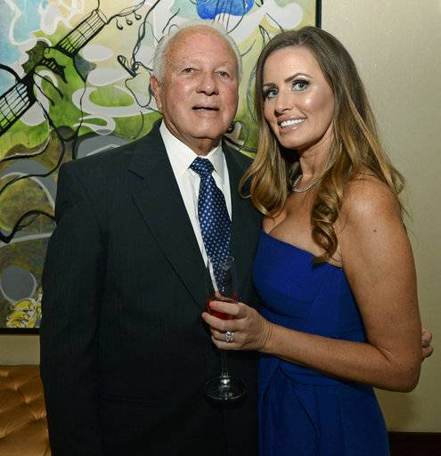 Former Louisiana Gov. Edwin Edwards, left, celebrates his 90th birthday with his wife, Trina Edwards, Saturday, Aug. 12, 2017, at the Renaissance Hotel in Baton Rouge, La. (Hilary Scheinuk /The Advocate via AP)