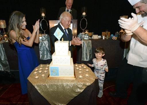 From left, Trina Edwards and her husband former Louisiana Gov. Edwin Edwards applaud with executive chef Drue Vitter, right, after their son, Eli, second from right, blew out the candles as Edwards celebrates his 90th birthday, Saturday, Aug. 12, 2017, at the Renaissance Hotel in Baton Rouge, La. (Hilary Scheinuk /The Advocate via AP)