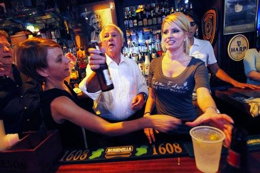 FILE - In this Aug. 23, 2011 file photo, former Louisiana Governor Edwin Edwards, 84, and his wife Trina Scott Edwards, 32, serve as honorary bartenders at Molly's On The Market Bar during a Press Club of New Orleans function in New Orleans. Louisiana's four-term former governor Edwards is having an ostentatious 90th birthday bash, Saturday, Aug. 12, 2017, with a $250-per-person price tag to attend. The powerful and charismatic Edwards was the dominant figure in Louisiana politics for decades before he went to federal prison for a corruption conviction. Out of prison for six years, he's got a wife five decades his junior, a 4-year-old son and continued popularity in his home state.