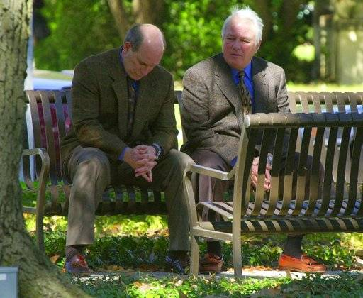 FILE - In this Feb. 22, 2000 file photo, former Louisiana Gov. Edwin Edwards, right, and his son Stephen share a moment on a park bench in front of the federal courthouse in Baton Rogue, La. Both men were on trial on federal gambling and corruption charges. Louisiana's four-term former governor Edwin Edwards is having an ostentatious 90th birthday bash, Saturday, Aug. 12, 2017, with a $250-per-person price tag to attend. The powerful and charismatic Edwards was the dominant figure in Louisiana politics for decades before he went to federal prison for a corruption conviction. Out of prison for six years, he's got a wife five decades his junior, a 4-year-old son and continued popularity in his home state.