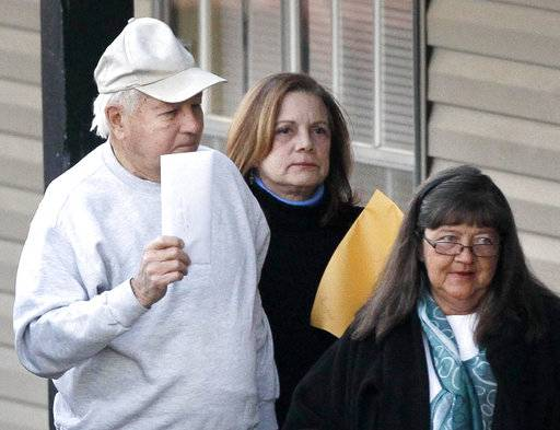 FILE - In this Jan. 13, 2011 file photo, former Louisiana Gov. Edwin Edwards arrives with his daughter Anna Edwards, center, at the Ecumenical House, a halfway house, to begin serving the remainder of his prison sentence after being released from the Oakdale Federal penitentiary in Baton Rouge, La. Louisiana's four-term former governor Edwin Edwards is having an ostentatious 90th birthday bash, Saturday, Aug. 12, 2017, with a $250-per-person price tag to attend. The powerful and charismatic Edwards was the dominant figure in Louisiana politics for decades before he went to federal prison for a corruption conviction. Out of prison for six years, he's got a wife five decades his junior, a 4-year-old son and continued popularity in his home state.